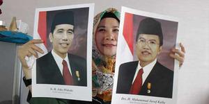 Foto Resmi Jokowi-JK Versi Tersenyum Lebar Kurang Diminati