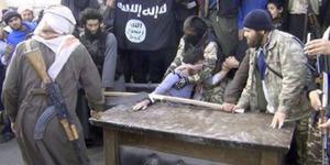ISIS Eksekusi Potong Tangan Maling Di Hadapan Anak-Anak